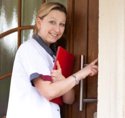 caregiver knocking on a door