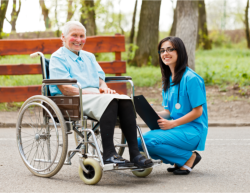 caregiver and her patient on wheelchair